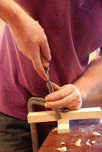 kopshout weg snijden met beitel